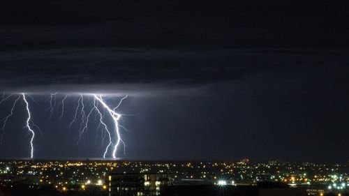 A lightning storm over the sea shot from a balcony in Adelaide's CBD.