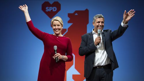 Franziska Giffey, left, top candidate of the Berlin SPD for the office of Governing Mayor, and Raed Saleh, co-party leader of the Berlin SPD take the stage at the election party of the Berlin SPD in Kreuzberg, Berlin on Sunday.