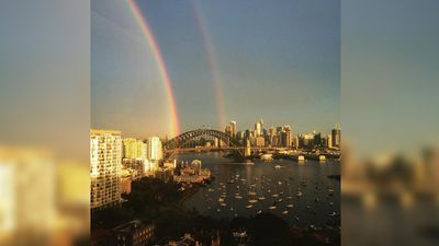 This person's view of Sydney Harbour was already glorious, but the double rainbow makes it even better. (Twitter, @frockandroll)