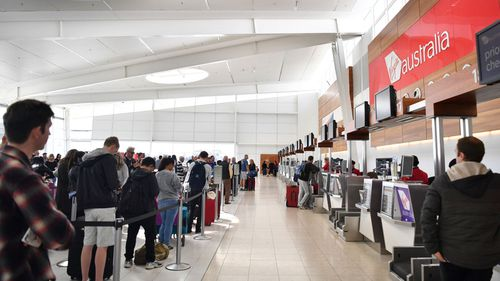 Virgin Australia customers are being checked in manually. (AAP)