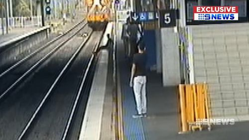 He throws something onto the tracks before getting out of the way. Picture: Supplied