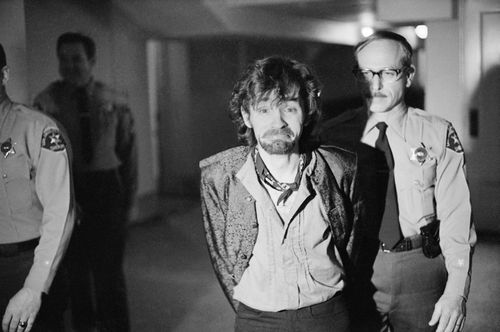 In this Dec. 21, 1970 file photo, Charles Manson reacts to photographers as he goes to lunch after an outbreak in court that resulted in his ejection, along with three female co-defendants, in the Sharon Tate murder trial.