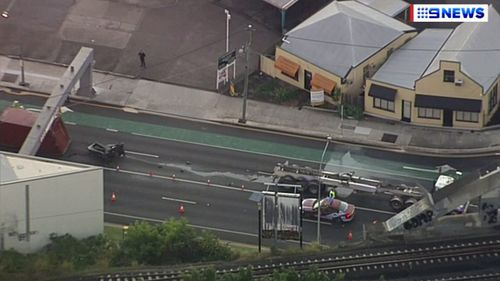 Queensland Police attend an accident involving a truck which lost its load on Annerley Road in Woolloongabba, near Brisbane CBD.