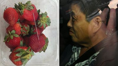 Woman charged over strawberry contamination crisis