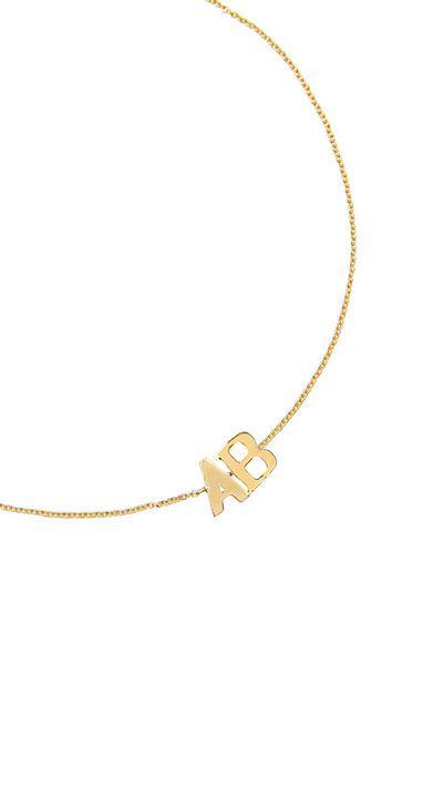"<p><a href=""http://www.aristidesfinejewels.com/two-letter-monogram-bracelets/"" target=""_blank"">Two Letter Monogram Bracelet, $340, Claire Aristides</a></p>"