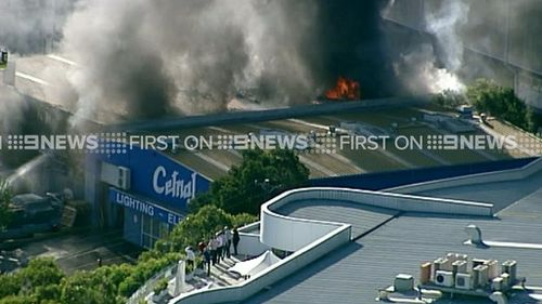 More than 50 firefighters are at the scene. (9NEWS)