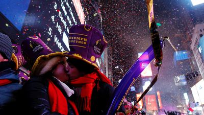 <p>The world has welcomed 2017 in spectacular fashion, with glittering fireworks lighting up night skies in major cities.</p> <p><br> A couple share a midnight kiss among fireworks and confetti in Times Square, New York City. <br> (AFP)</p>