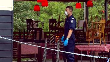 Search for gunman who held up Perth cafe