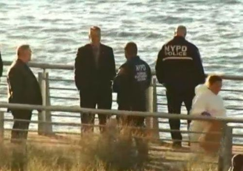 Police at the bank of the Hudson River last week close to where the bodies of the sisters were found. (NYPD).