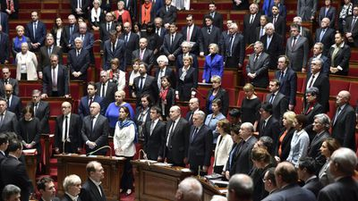 French deputies hold a minute's silence for victims of the Brussels attacks, at the start of a series of questions to government in Paris. (AFP)