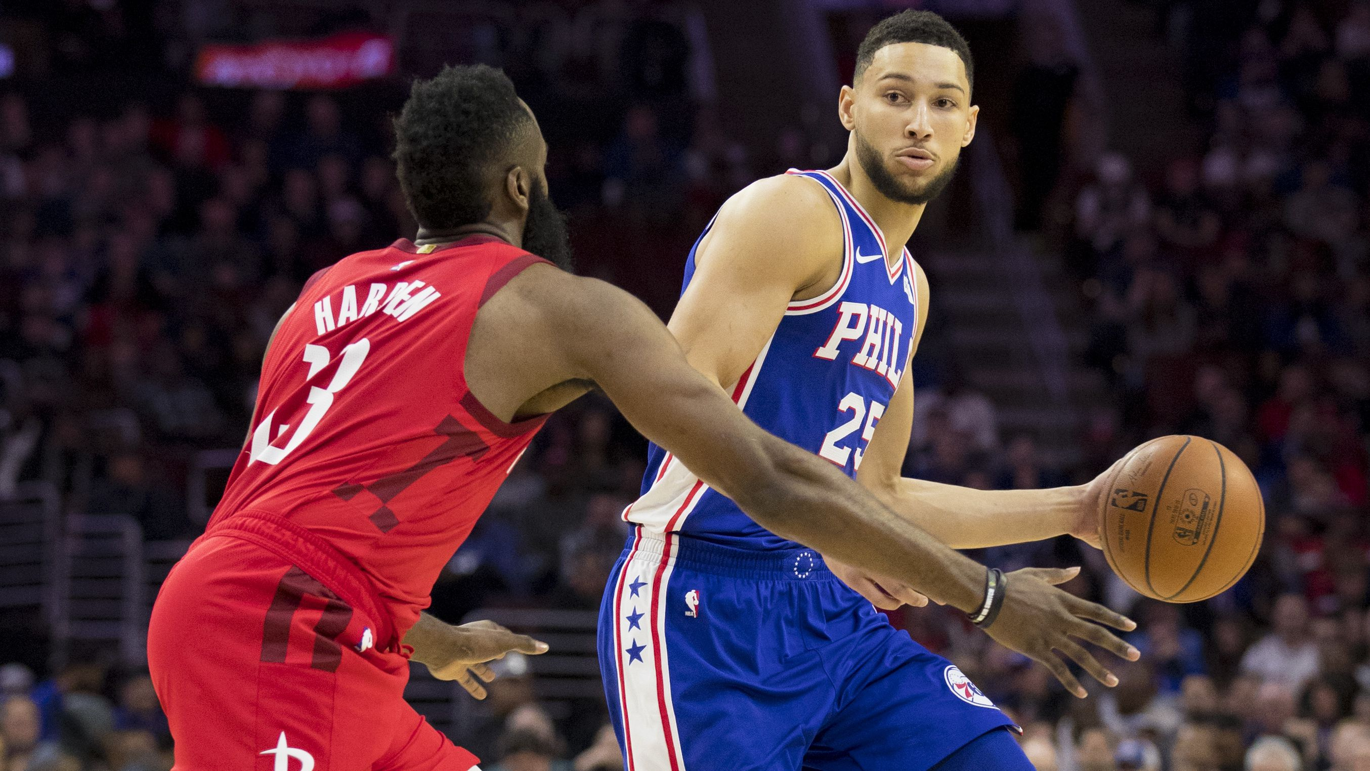 Ben Simmons dribbles the ball against James Harden.