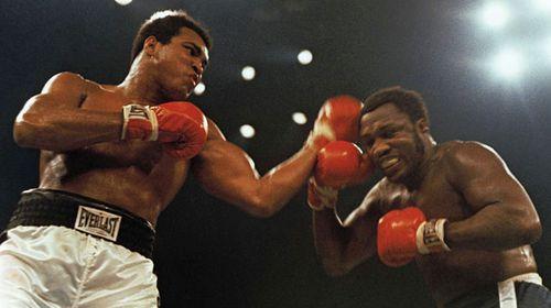 Muhammad Ali lands a blow against Joe Frazier in 1974. (AAP)