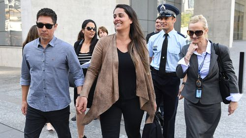 The brother of Fabiana Palhares, Raphael Palhares (left), leaves the Supreme Court with supporters following the sentencing. Picture: AAP