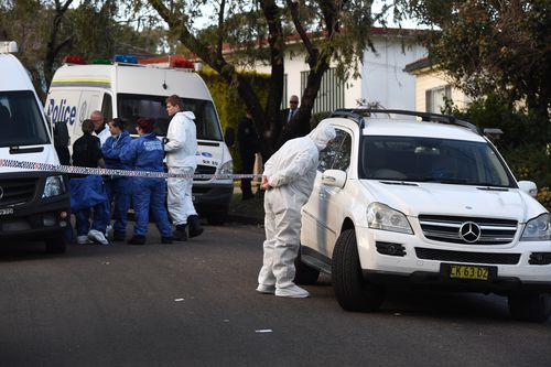 NSW Police and forensic services officers at the scene. (AAP)