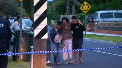 Distraught relatives after the shooting. (9NEWS)