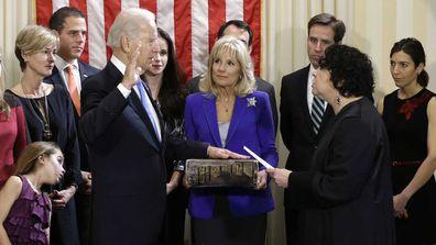 Joe Biden takes the oath of office alongside Kathleen and Hunter Biden, far left, and Beau and Hallie Biden, far right. (AAP)