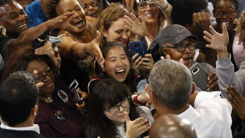 A crowd of starstruck fans welcome a familiar face: Former President Barack Obama hitting the campaign trail in Nevada.