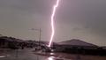 Moment lightning strikes parked car