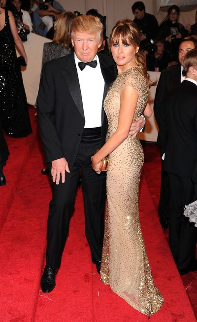 Donald and Melania Trump in Reem Acra attend the Alexander McQueen: Savage Beauty Costume Institute Gala at The Metropolitan Museum of Art in 2011