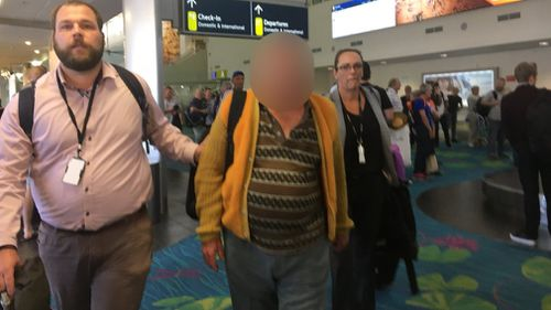 The accused man (centre) was extradited from Melbourne to Darwin today. Picture: 9NEWS