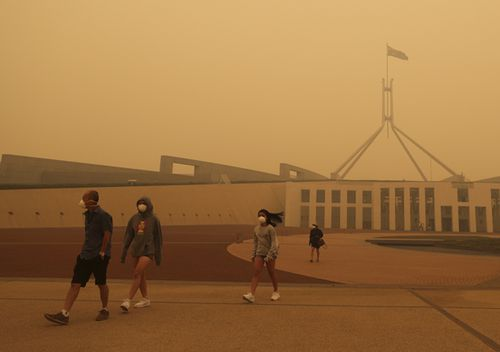 Visitors to Parliament House forced to wear face masks after smoke from bushfires blankets Canberra in a haze with hazardous air quality, on Sunday.