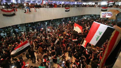 Hundreds of protesters storm Iraq's Green Zone and invade parliament
