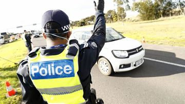 Victoria Police perform checks at a road block on the Princes Freeway just before Little River on July 09, 2020 in Melbourne, Australia. The States Premier has warned against breaking the rules.