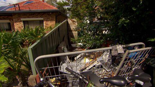 Robert's next-door home is filled with rubbish.