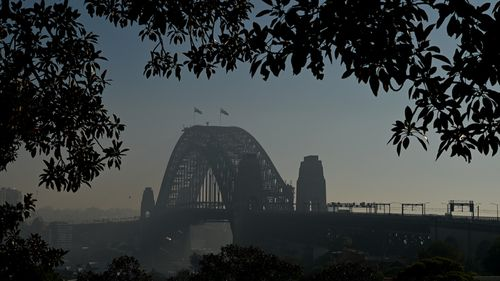 The Sydney Harbour Bridge seen through smoke haze today.