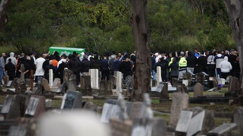 Bilal Hamze funeral. The coffin is carried through gathered mourners to its final resting place in Rookwood Cemetery.