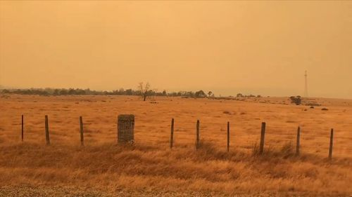 Visibility remains poor as the fire rages.