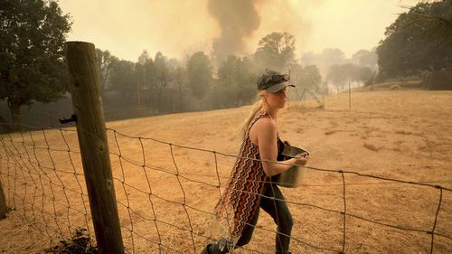 In total, 14,000 firefighters were battling blazes across California, which is seeing earlier, longer and more destructive wildfire seasons