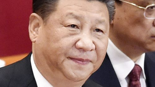 Chinese President Xi Jinping attends the opening session of the Chinese People's Political Consultative Conference at the Great Hall of the People in Beijing. (AAP)