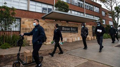 Cleaners arrive at Rose Bay Secondary College, following a student testing positive to COVID-19.