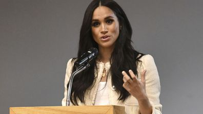 Britain's Meghan, Duchess of Sussex, speaks during a school assembly as part of a surprise visit to the Robert Clack Upper School in Dagenham, Essex, in eastern London, to celebrate International Women's Day, Friday, March 6, 2020