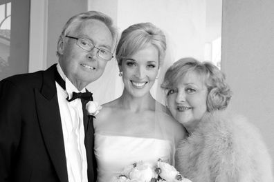 Louise Momber with her mum and dad on her wedding day
