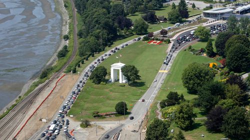 Cars line-up at a US-Canada border crossing at Blaine, Washington. Picture: AP