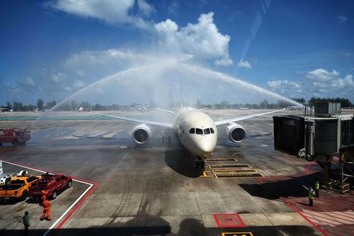 Celebratory sprays of water are splashed over an Etihad Airways airplane arriving from Abu Dhabi carrying passengers for the Phuket Sandbox tourism scheme. (Photo by Lillian SUWANRUMPHA / AFP) (Photo by LILLIAN SUWANRUMPHA/AFP via Getty Images)