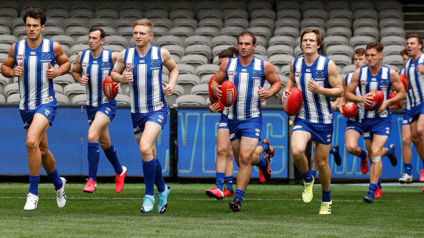 AFL says it won't push North Melbourne to Tasmania, but former Roos boss disagrees
