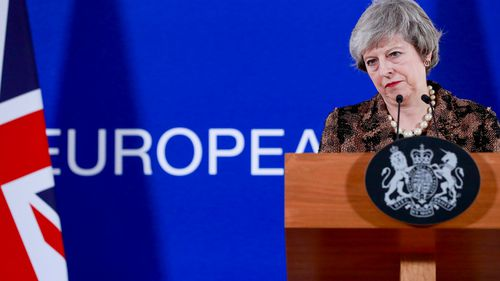 UK Prime Minister Theresa May addresses a media conference in Brussels.