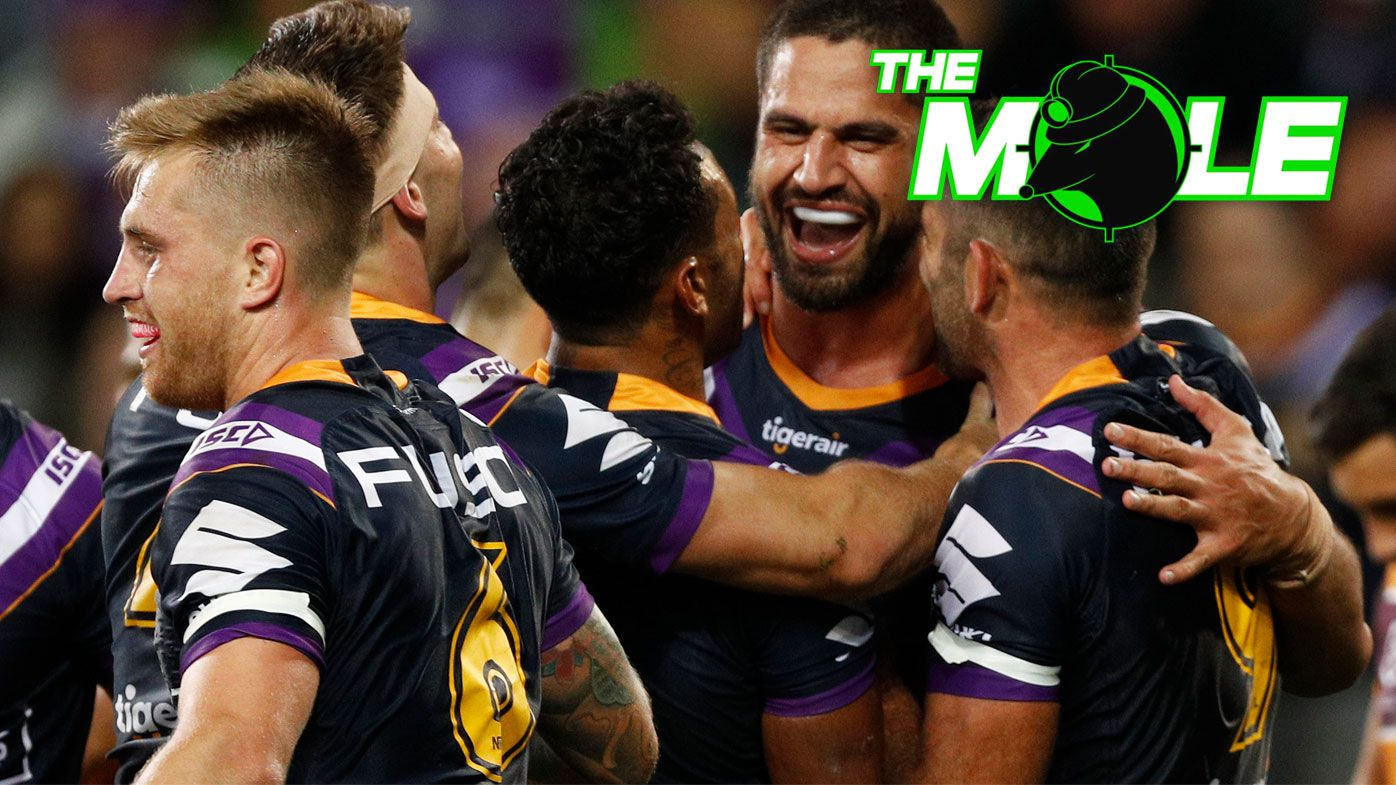 Melbourne Storm players celebrate.