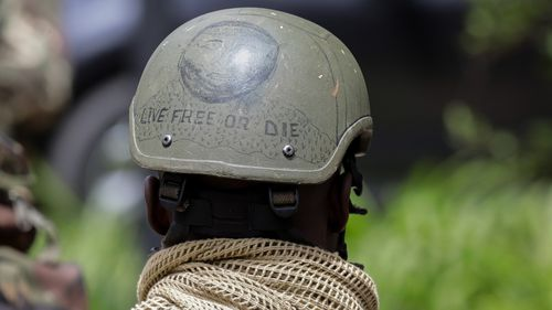 A Kenyan special forces soldier stands watch outside the compound.