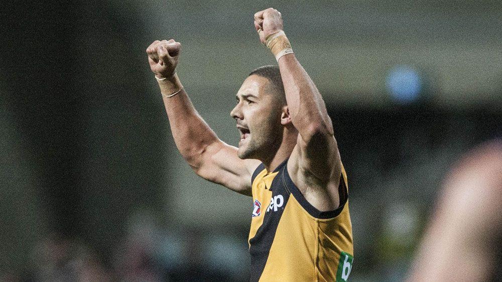 Cotchin stars, Tigers bt Dockers in AFL