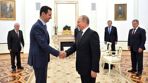 Syrian President Bashar al-Assad (left) meeting with Russian President Vladimir Putin in Moscow on October 21.