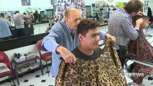 Tony Battaglia is hairdressing at 92. (9NEWS)