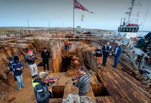 Restorers aboard the wreck. (Photo: Maud Returns Home).