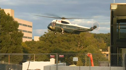 Marine One lands at Walter Reed National Military Medical Center to fly US President Donald Trump back to the White House