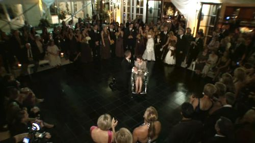 The groom got down on his knees and danced with his wheel-chair bound mother.