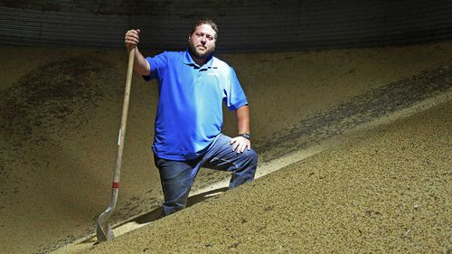 Soybean farmer Michael Petefish stands inside a bin with soybeans from last season's crop at his farm near Claremont in southern Minnesota. (AP)