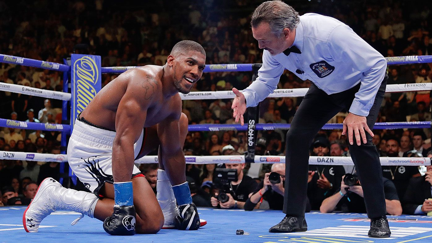 Anthony Joshua waits during the referee's count after he was knocked down during the seventh round